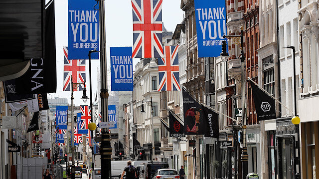 "Union Jack and ""Thank you"" flags are seen on Bond Street in London"