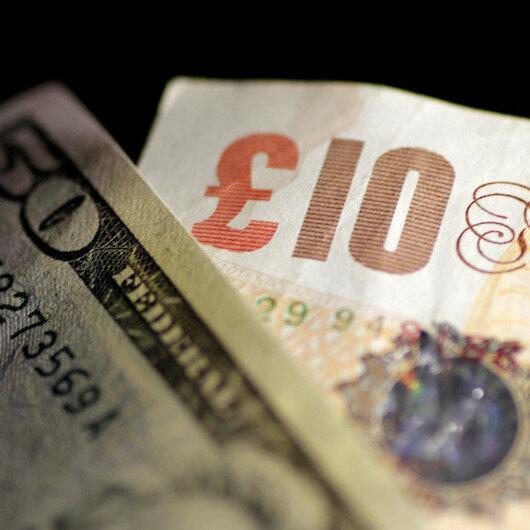 Sterling rises versus weaker dollar; UK sets out plans to re-open shops