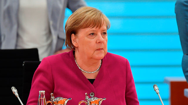 German Chancellor Angela Merkel looks on at the start of the weekly cabinet meeting on May 27, 2020 at the Chancellery in Berlin, Germany. Due to the required distance to prevent from the coronavirus infection, the meeting takes place in the International Conference Room and not in the usual cabinet room. Tobias Schwarz/Pool via REUTERS
