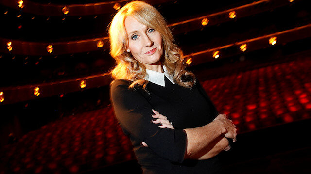 """FILE PHOTO: Author J.K. Rowling poses for a portrait while publicizing her adult fiction book """"The Casual Vacancy"""" at Lincoln Center in New York October 16, 2012. REUTERS/Carlo Allegri/File Photo"""
