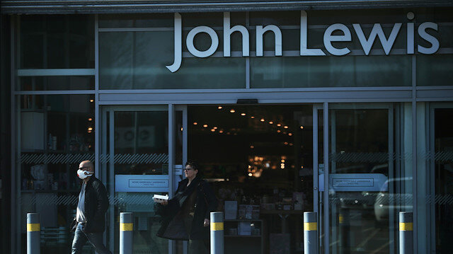 A man leaves a John Lewis store