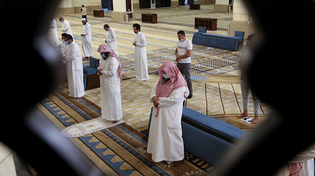 Muslims perform the Al-Fajr prayer inside the Al-Rajhi Mosque