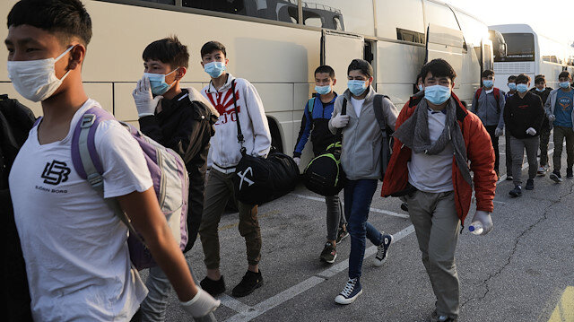 File photo: A group of unaccompanied children from overcrowded migrant camps who will be transferred to Germany and Luxembourg, wear protective face masks as a precaution against the spread of coronavirus disease (COVID-19) as they arrive at the port of Piraeus, Greece, April 15, 2020