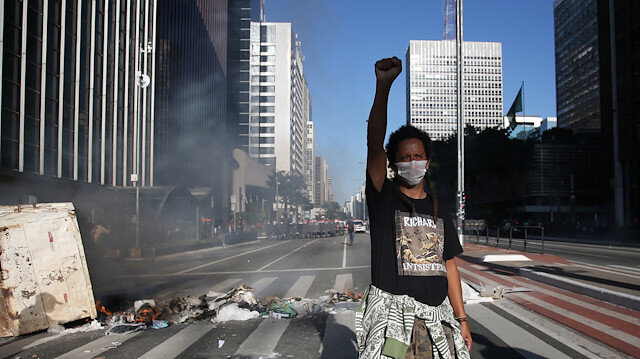 A demonstrator gestures during a protest against Brazilian President Jair Bolsonaro at Paulista avenue in Sao Paulo, Brazil, May 31, 2020.