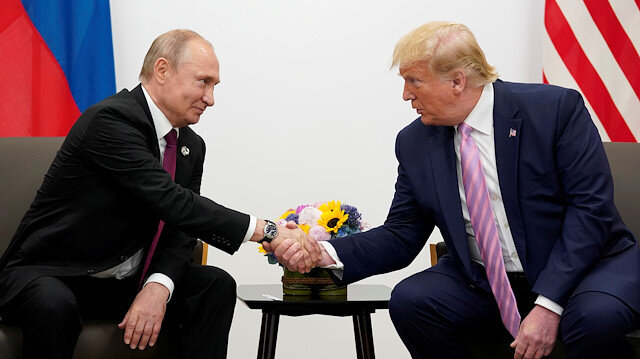 FILE PHOTO: Russia's President Vladimir Putin and U.S. President Donald Trump shake hands during a bilateral meeting at the G20 leaders summit in Osaka, Japan, June 28, 2019.