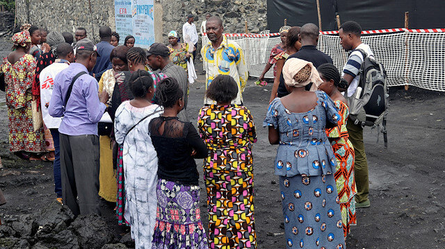 Congolese residents gather around Medecins Sans Frontieres (MSF) health workers as they prepare the introduction of the second ebola vaccine produced by Johnson & Johnson, in Majengo neighborhood of Goma, Democratic Republic of Congo, November 14, 2019.