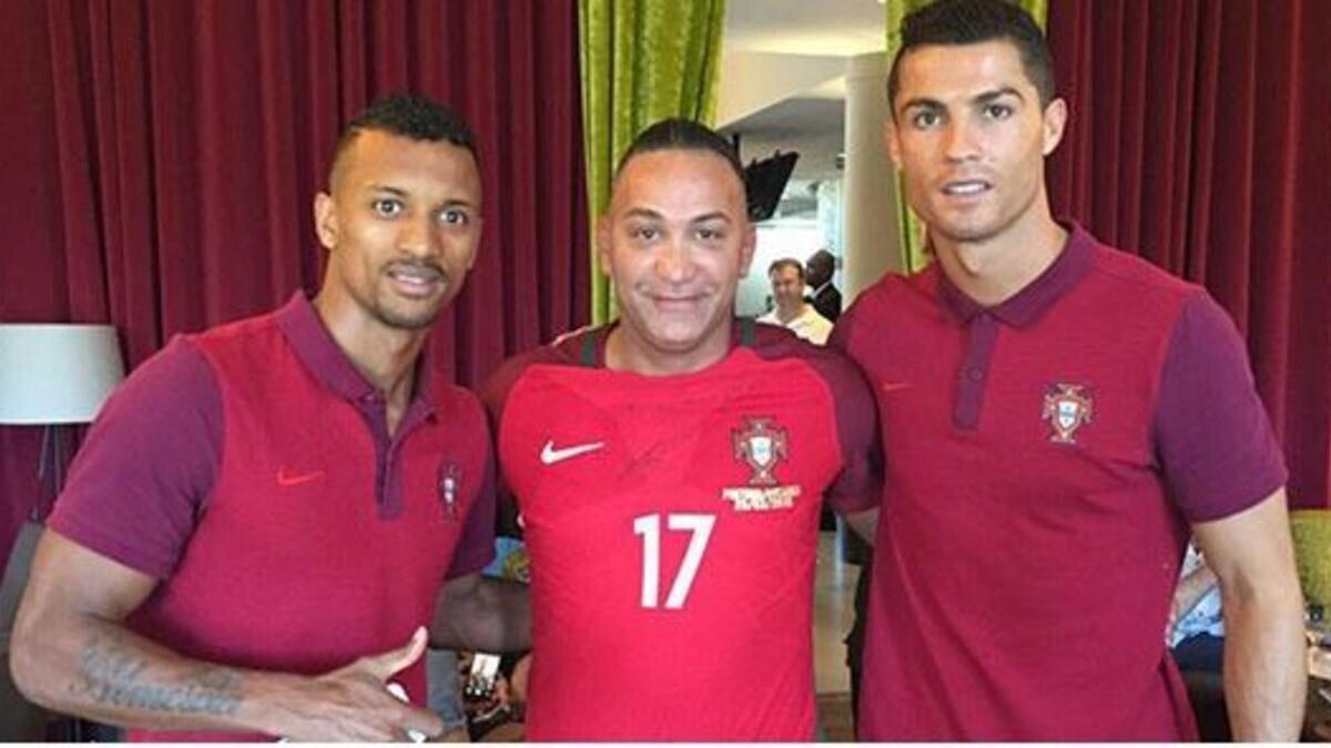 Devrim Akarsu Portekizli yıldızlar Ronaldo ve Nani ile birlikte.