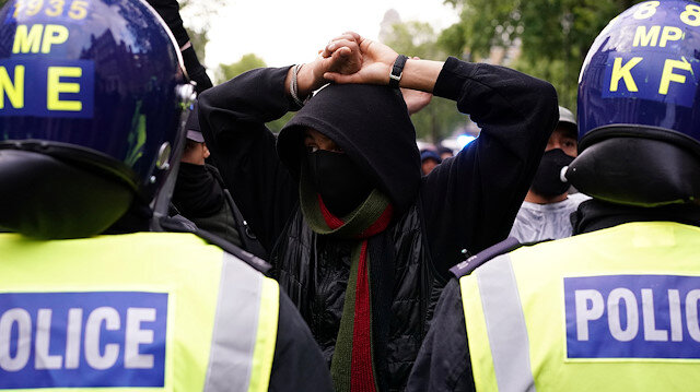 Police officers are seen with demonstrators on Whitehall during a Black Lives Matter protest in London, following the death of George Floyd who died in police custody in Minneapolis, London, Britain, June 6, 2020