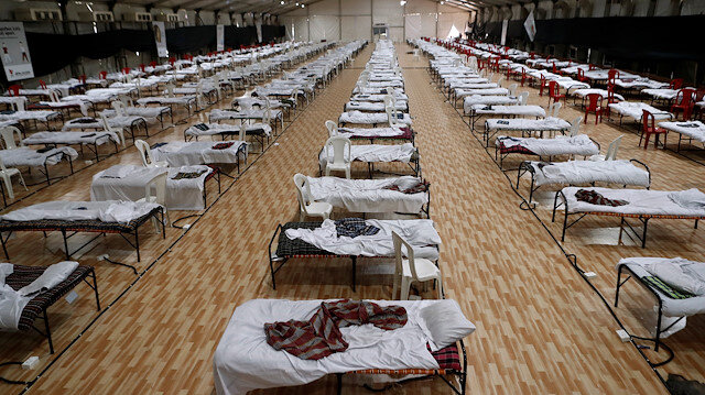 Beds are seen inside a recently constructed makeshift hospital and quarantine facility