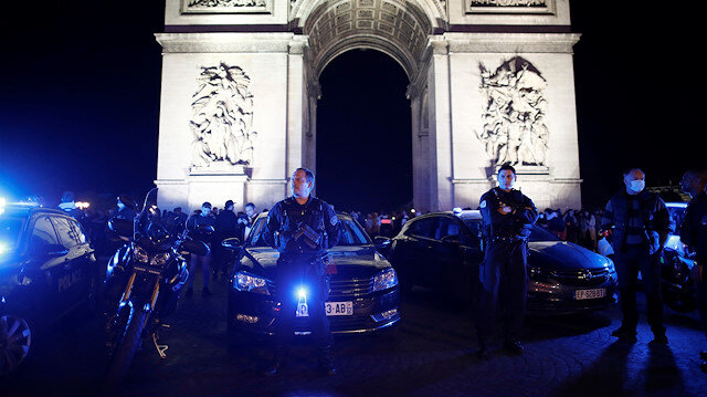 Police officers attend a demonstration against French Interior Minister Christophe Castaner's reforms, including ditching a controversial chokehold method of arrest, following the death in Minneapolis police custody of George Floyd, near Arc de Triomphe in Paris, France, June 14, 2020.