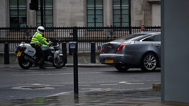 File photo: The dented car carrying Britain's Prime Minister Boris Johnson leaves the Houses of Parliament