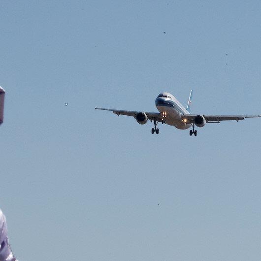 Beijing halts over 1,250 flights amid new wave of virus