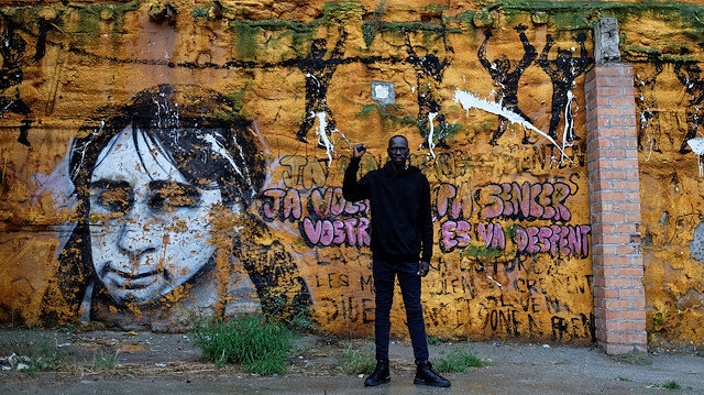 African immigrant Serigne Mamadou, 41, an activist and fruit picker, poses near the place where his compatriots (not pictured) live on the streets while waiting for available fruit picking jobs, in Lleida, Spain, June 16, 2020. Picture taken June 16, 2020. REUTERS/Nacho Doce