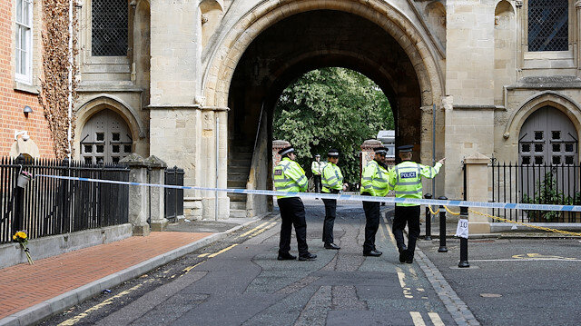 Police officers stand behind the cordon at the scene of multiple stabbings in Reading, Britain, June 21, 2020