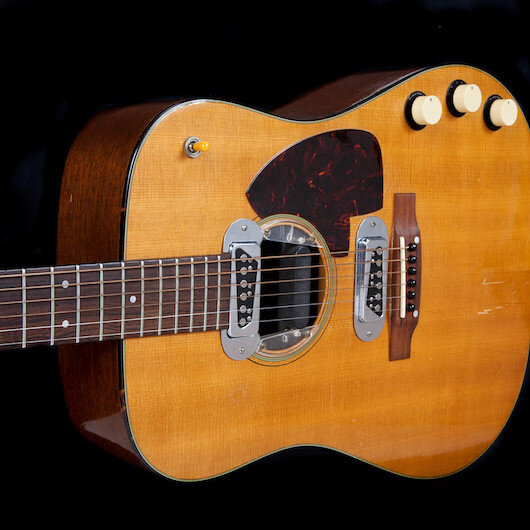 Late rock star's guitar sells for record $6M at auction
