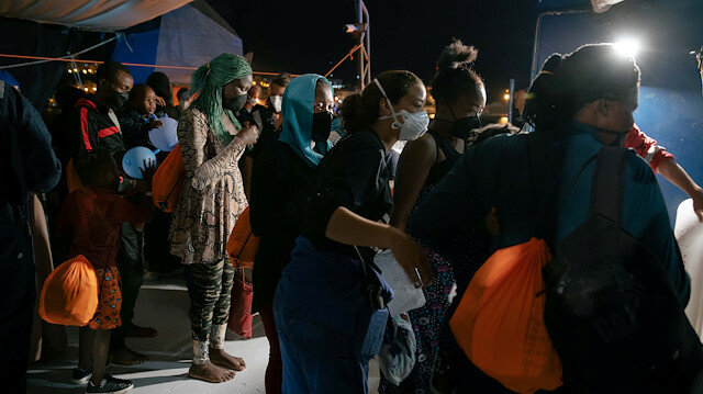 File photo: Migrants wearing face masks as a means of protection against the coronavirus disease (COVID-19) wait to disembark from the German NGO search and rescue ship Sea-Watch 3, before being transferred on board the Moby Zaza ferry to be quarantined, in the port of Porto Empledocle, Italy, June 21, 2020