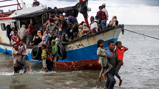 File photo: Locals evacuate Rohingya refugees from a boat at a coast of North Aceh, Indonesia, June 25, 2020 in this photo taken by Antara