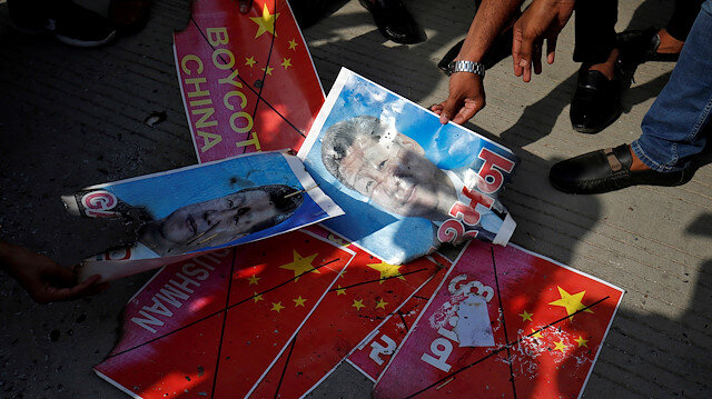 Members of National Students' Union of India (NSUI) burn posters of Chinese President Xi Jinping during a protest against China, in Ahmedabad, India, June 18, 2020. REUTERS/Amit Dave