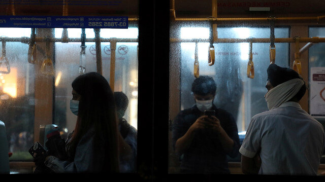 People wearing protective masks travel on a public bus amid the coronavirus disease (COVID-19) outbreak in Kuala Lumpur, Malaysia, June 26, 2020. REUTERS/Lim Huey Teng