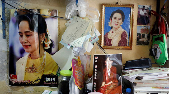 FILE PHOTO: Photographs of Myanmar State Counselor Aung San Suu Kyi hung in a shop in Yangon, Myanmar, January 23, 2020. REUTERS/Ann Wang/File Photo