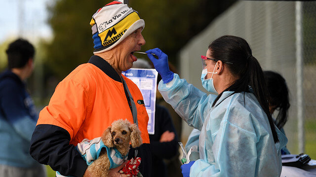 A medical professional administers a test to a member of the public at a pop-up coronavirus disease (COVID-19) testing facility, as the state of Victoria experiences a spike in cases, in Melbourne, Australia, June 26, 2020. AAP Image/James Ross via REUTERS