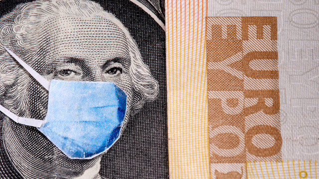 George Washington is seen with printed medical masks on the one Dollar near Euro banknote in this illustration taken, March 31, 2020. REUTERS/Dado Ruvic/Illustration