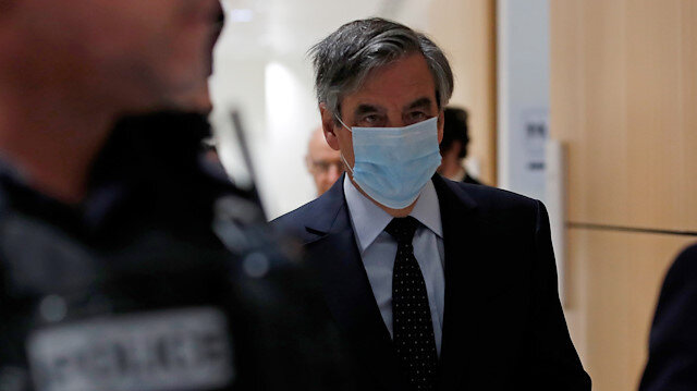 Former French prime minister Francois Fillon, wearing a protective face mask, arrives for the verdict in his trial over a fake jobs scandal at the courthouse in Paris, France, June 29, 2020.