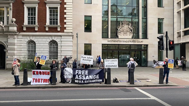 Assange supporters stage a protest outside court