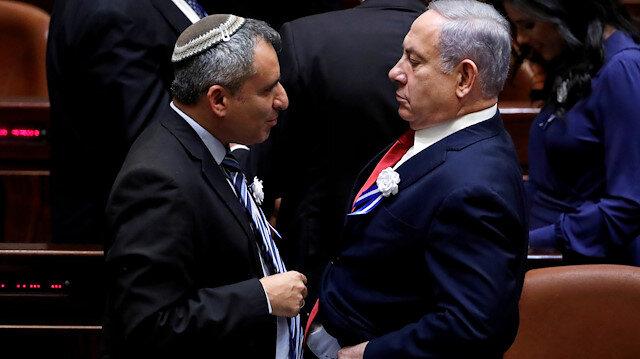 FILE PHOTO: Israeli Prime Minister Benjamin Netanyahu speaks with member of the Knesset for Likud Zeev Elkin as they attend the swearing-in ceremony of the 22nd Knesset, the Israeli parliament, in Jerusalem October 3, 2019. REUTERS/Ronen Zvulun/File Photo