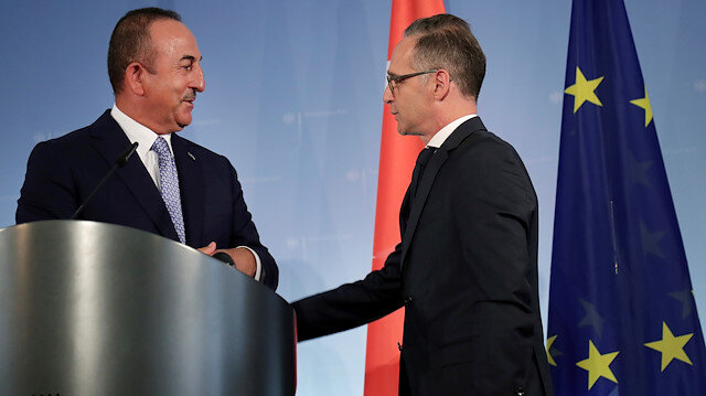 German Foreign Minister Heiko Maas and Turkish Foreign Minister Mevlut Cavusoglu talk after addressing the media during a joint news conference after a meeting in Berlin, Germany July 2, 2020. Michael Sohn/Pool via REUTERS