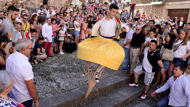 A skirt wearing dancer on stilts performs the whirling Dance of the Zancos on Saint Mary Magdalene's feast day in Anguiano, Spain, July 22, 2018. REUTERS/Vincent West
