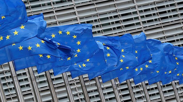European Union flags flutter outside the European Commission headquarters