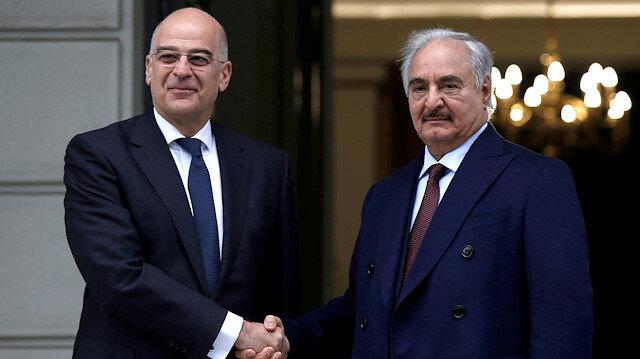 Greek Foreign Minister Nikos Dendias welcomes Libyan commander Khalifa Haftar