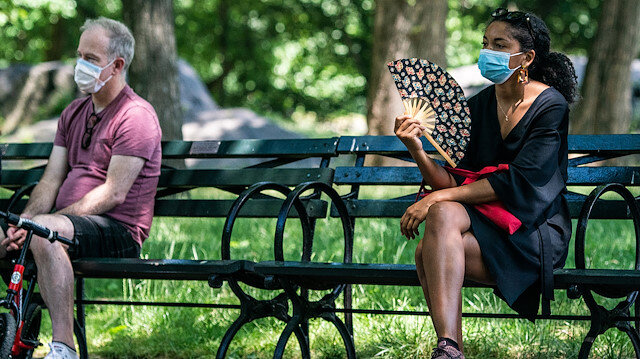 People enjoy the weather in Central Park, the day before the city starts phase two of reopening after the lockdown due to the coronavirus disease (COVID-19), in the Manhattan borough of New York City, U.S., June 21, 2020. REUTERS/Jeenah Moon