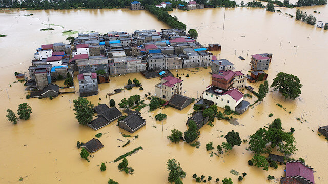 An aerial view shows buildings and farmlands partially submerged in floodwaters following heavy rainfall in Duchang county, Jiangxi province, China July 8, 2020