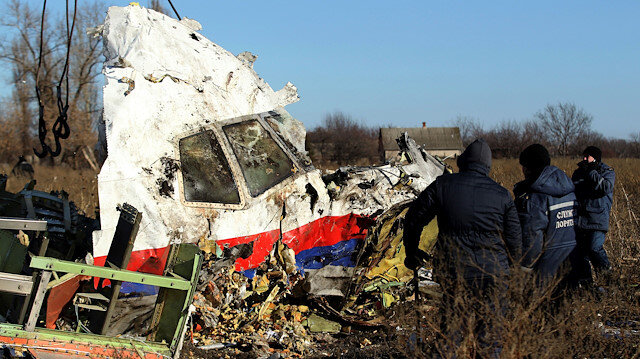 FILE PHOTO: Local workers transport a piece of wreckage from Malaysia Airlines flight MH17 at the site of the plane crash near the village of Hrabove (Grabovo) in Donetsk region, eastern Ukraine, November 20, 2014