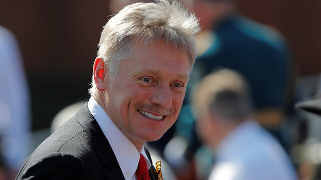 Kremlin spokesman Dmitry Peskov smiles before the Victory Day Parade in Red Square in Moscow, Russia June 24, 2020. The military parade, marking the 75th anniversary of the victory over Nazi Germany in World War Two, was scheduled for May 9 but postponed due to the outbreak of the coronavirus disease (COVID-19). REUTERS/Maxim Shemetov