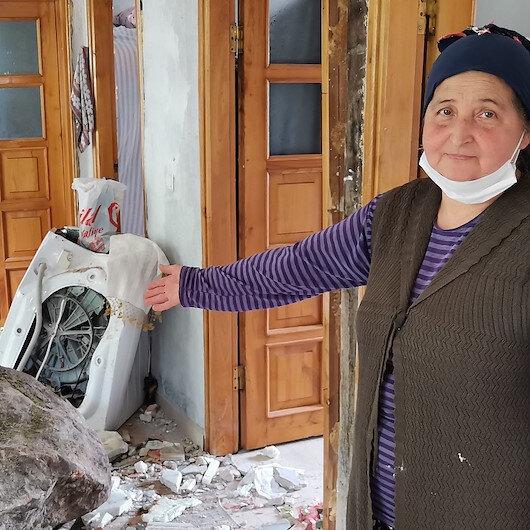 Yamaçtan yuvarlanan kaya, duvarını yıktığı eve girdi: Çamaşır makinesi bizi kurtarmış