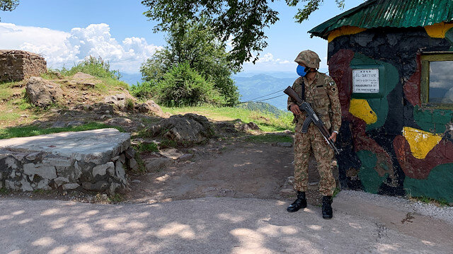 Pakistan Army soldier stands guard at a hilltop post during a trip organised by the army, near the Line of Control (LoC), in Charikot Sector, Kashmir July 22, 2020. Picture taken July 22, 2020. REUTERS/Charlotte Greenfield