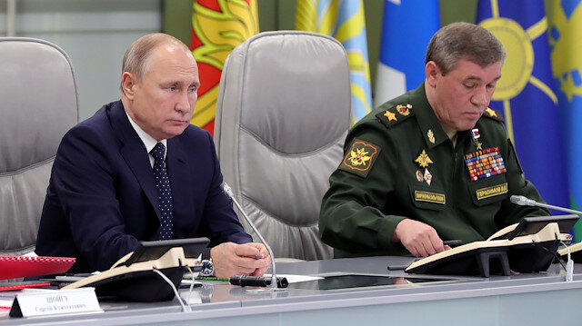 Russia's President Vladimir Putin (L) visits the National Defence Control Centre (NDCC) to oversee the test of a new Russian hypersonic missile system called Avangard, which can carry nuclear and conventional warheads, with Chief of the General Staff of Russian Armed Forces Valery Gerasimov seen nearby, in Moscow, Russia December 26, 2018. Sputnik/Mikhail Klimentyev/Kremlin via REUTERS