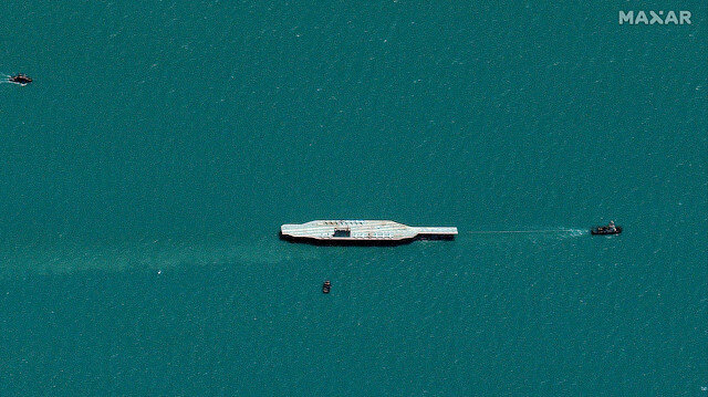 Iran's refurbished mockup aircraft carrier, used previously as a simulated U.S. target during a February, 2015 Iranian naval war games exercise, is seen towed by a tugboat near Bandar Abbas, Iran July 25, 2020. Picture taken July 25, 2020. Satellite image ©2020 Maxar Technologies/via Reuters