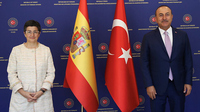 Turkish Foreign Minister Mevlut Cavusoglu and his Spanish counterpart Arancha Gonzalez Laya pose before their meeting in Ankara, Turkey, July 27, 2020