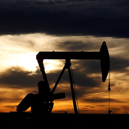 Oil mixed as US dollar plunge ends and virus cases rise