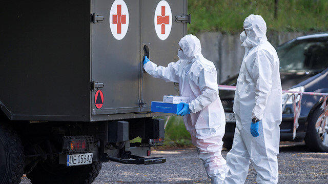 Health workers wearing protective gear are seen at a mobile testing station for miners of the Bielszowice coal mine, following the coronavirus disease (COVID-19) outbreak in Ruda Slaska, Poland July 27, 2020. Grzegorz Celejewski/Agencja Gazeta/via REUTERS