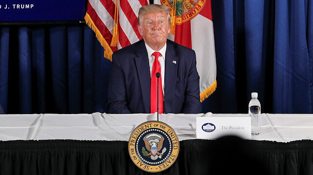 """U.S. President Donald Trump participates in a """"COVID-19 Response and Storm Preparedness"""" event with Florida Governor Ron DeSantis and U.S. Health and Human Services (HHS) Secretary Alex Azar at the Pelican Golf Club in Belleair, Florida, U.S., July 31, 2020. REUTERS/Tom Brenner"""