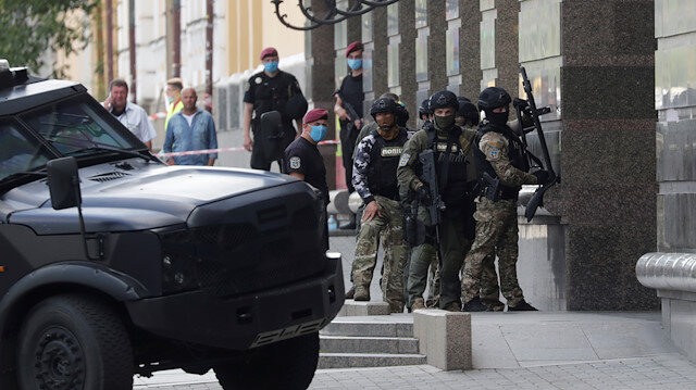 Members of a Ukrainian special forces unit are seen outside a building where an unidentified man reportedly threatens to blow up a bomb in a bank branch, in Kyiv, Ukraine August 3, 2020