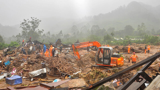Rescue workers look for survivors at the site of a landslide during heavy rains in Idukki, Kerala, India, August 7, 2020.
