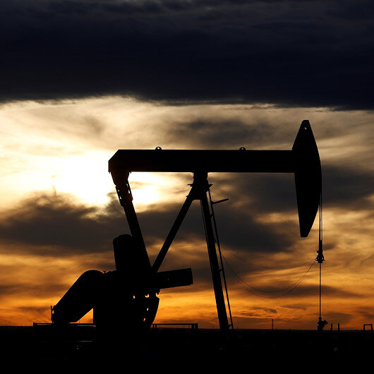 Oil prices slightly up as Iraq, Saudi vow to cut prod.