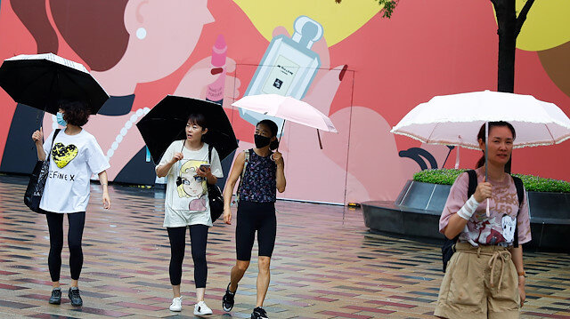 People carry umbrellas on a rainy day following an outbreak of the coronavirus disease (COVID-19) in Beijing, China August 12, 2020.