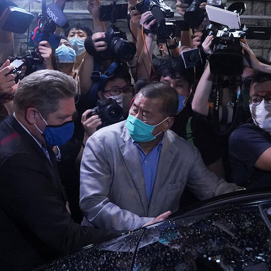 Hong Kong releases media tycoon, others on bail